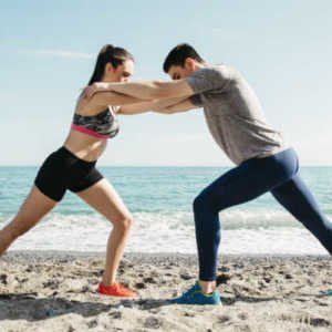 fit couple stretching on the beach together protect couple sex