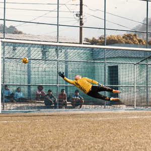 man trying to stop a soccer ball from going in the goal posts soccer science tactics