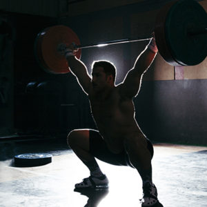 man like ettiene smit doing a powerlift in the dark