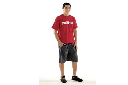 belly off club member stands in a mens health shirt