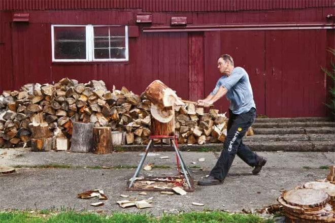 Dave Jewett chopping wood
