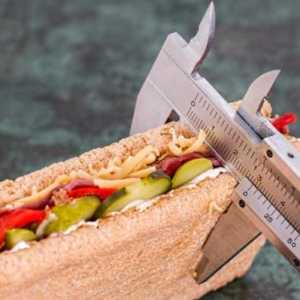 a measuring tool measuring the size of a sandwich