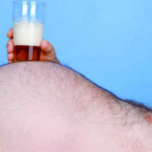 man with a big stomach resting a beer on his tummy