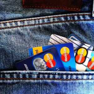 jeans back pocket filled with lost of bank and credit cards