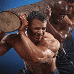 fit men carrying a log on their shoulders