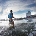 A competitor runs to the beach during the swimming portion at Red Bull Surf & Rescue at Atlantic City Beach in Atlantic City, NJ, USA on 21 July, 2015