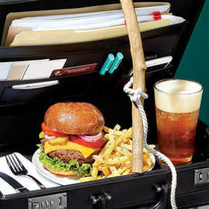a briefcase holding a lot of junkfood at work