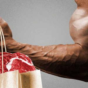 man lifting a bag of groceries