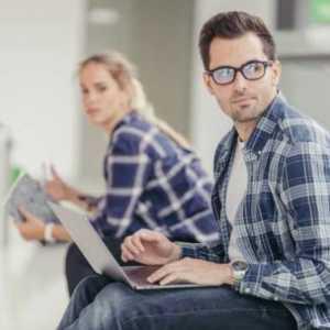 man-in-glasses-using-laptop