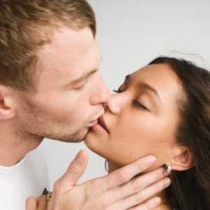 man kissing woman on the lips