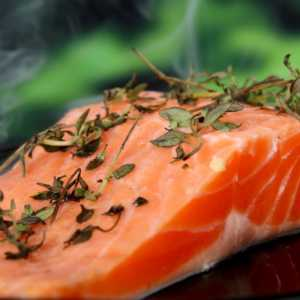 a piece of salmon covered in rosemary