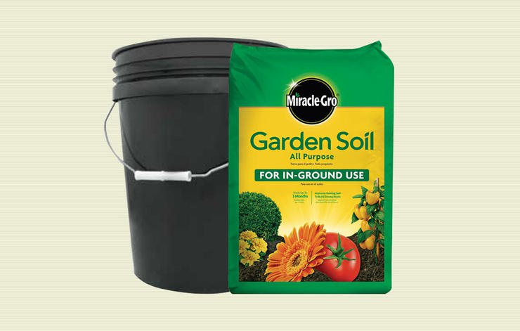 Backyard Items backyard-items-use-weights-bucket-of-soil - men's health
