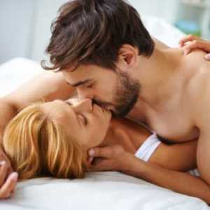 couple in love kissing in bed