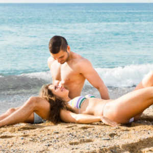 man-and-woman-relaxing-on-the-sand-at-a-beach