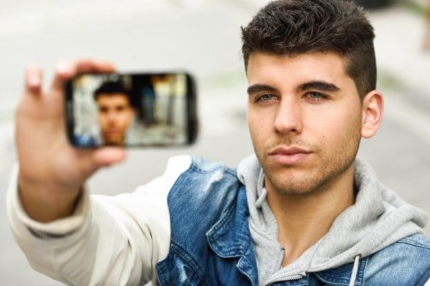 attractive-boy-taking-a-selfie_1139-352