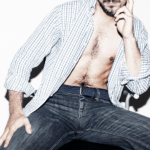 Man wearing an open shirt and jeans