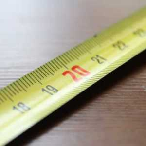 tape measure elongated and lying on a table