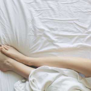 A women's legs in bed
