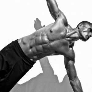 Fit guy doing a side plank