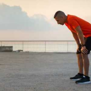 tired-male-athlete-having-break-after-jogging
