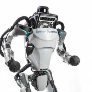 Atlas the humanoid robot stands with its arms up
