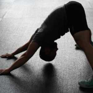 man stretching out sore muscles in the gym