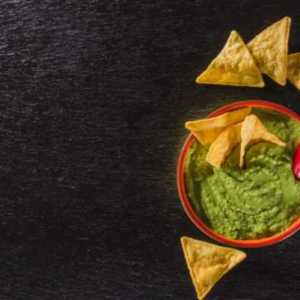 artistic-composition-with-guacamole-and-nachos