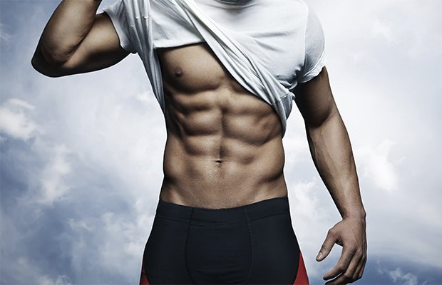 sculpt beach abs like this man lifting his shirt to reveal his six pack