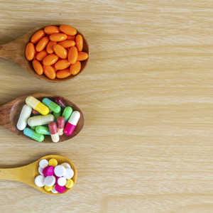 probiotic tablets and medicine on a wooden table