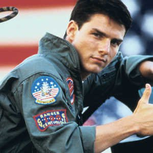 tom cruise as a pilot pulling a thumbs up