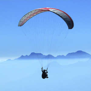 man paragliding as one of his adventures