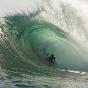 a guy bodyboarding at the Tand Invitational