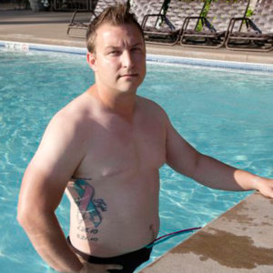bret miller, who was diagnosed with male breast cancer, standing in a pool