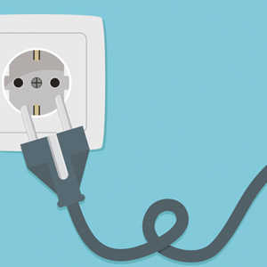 an electrical socket with a plug pulling out
