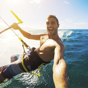 man kitesurfing in mauritius smiling Holiday For Active Travellers