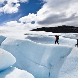 group of people trekking Patagonia and its glaciers