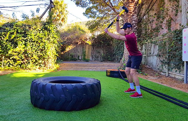 thrive fitness personal trainer brad tooley doing a hammer slam as part of a tabata workout