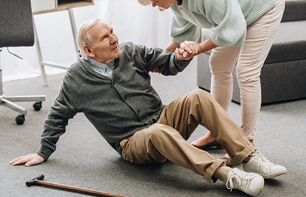 a woman helping a man with dementia