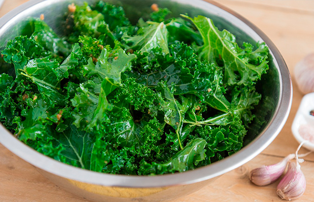 Kale in a silver bowl on a table