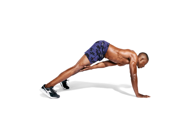 A man doing a Pushup and Plank Touch as part of a no-gear workout